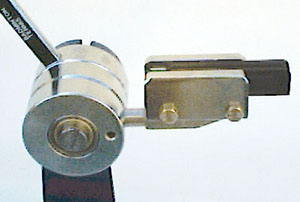 Linear ball bearing string gripper with spring clutch (ratchet)